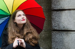 Girl with umbrella. Girl with color palette umbrella Stock Photography