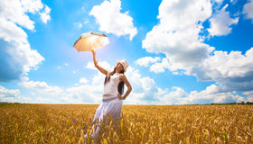 Girl with umbrella is enjoys summer day Royalty Free Stock Photography