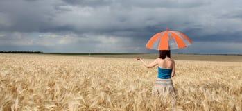 Girl with umbrella at field. Panoramic photo Royalty Free Stock Photos