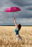 Girl with umbrella at field. Royalty Free Stock Photo