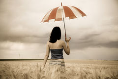 Girl with umbrella at field. In storm, Photo # 32 Royalty Free Stock Image