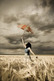 Girl with umbrella at field. In storm, Photo # 31 Stock Photo