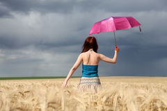 Girl with umbrella at field Royalty Free Stock Image