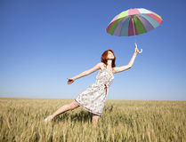 GIrl with umbrella at field Royalty Free Stock Photography