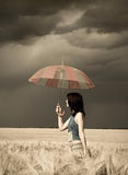 Girl with umbrella at field in retro style. 2 Stock Image