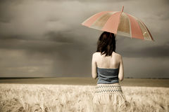 Girl with umbrella at field in retro style. Girl with umbrella at field. Photo in retro style #1 Stock Photo