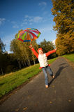 Girl with umbrella in a forest Stock Photos