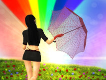 Girl with umbrella on grass field Royalty Free Stock Photo