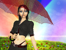 Girl with umbrella on grass field Stock Photo