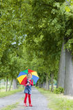 Girl with umbrella Stock Image