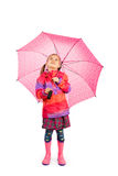 Girl and Umbrella. Little girl with big pink umbrella royalty free stock photography