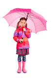 Girl and Umbrella. Little girl with big pink umbrella stock image