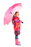 Girl and Umbrella. Little girl with big pink umbrella royalty free stock images