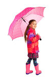 Girl With Umbrella. Little girl with big pink umbrella royalty free stock photo