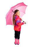 Girl With Umbrella. Little girl with big pink umbrella royalty free stock photos