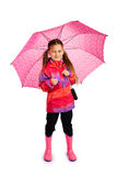 Girl With Umbrella. Little girl with big pink umbrella royalty free stock photography