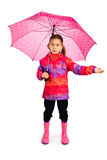 Girl With Umbrella. Little girl with big pink umbrella checking if it's still raining royalty free stock photos
