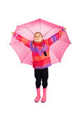 Girl With Umbrella. Little girl holding her big pink umbrella like wings royalty free stock images