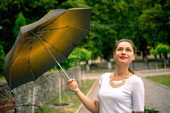 Girl with umbrella looking at the sky Stock Photos