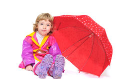 Girl with umbrella making face Royalty Free Stock Photos