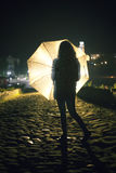Girl with umbrella. By night Royalty Free Stock Images