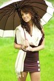 Girl with umbrella oudoors Stock Image