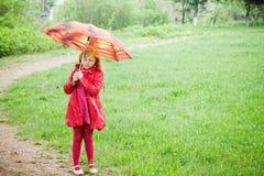 Girl with umbrella outdoor Stock Photos