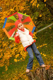 Girl with umbrella outdoors Stock Images