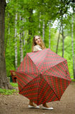 Girl with umbrella in park Stock Images