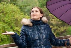 Girl with an umbrella in the park Stock Photos