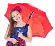 Girl with umbrella posing in studio. Royalty Free Stock Photo