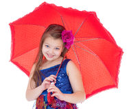 Girl with umbrella posing in studio. stock photo