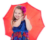 Girl with umbrella posing in studio. Stock Photo