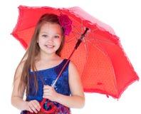 Girl with umbrella posing in studio.  royalty free stock image