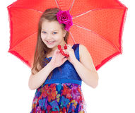 Girl with umbrella posing in studio. Royalty Free Stock Images