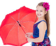 Girl with umbrella posing in studio. Stock Images