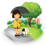 A girl with an umbrella and a puppy at the road Royalty Free Stock Photos