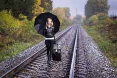 Girl, umbrella and rails Royalty Free Stock Images