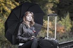 Girl, umbrella and rails Royalty Free Stock Photo