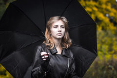Girl, umbrella and rails Royalty Free Stock Photography