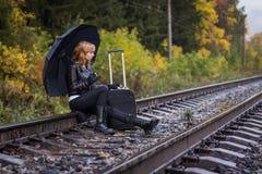 Girl, umbrella and rails Royalty Free Stock Photos