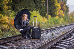 Girl, umbrella and rails Stock Photo