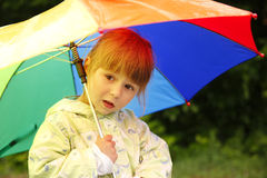 Girl with an umbrella in the rain Stock Photos