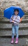 Girl with an umbrella in the rain Stock Photo