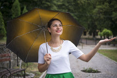 Girl with the umbrella in the rain Stock Photo