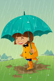 Girl with umbrella and raincoat playing in the mud Stock Photos