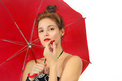Girl with umbrella and strawberry Royalty Free Stock Photography