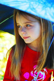 Girl and umbrella. stock images