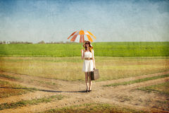 Girl with umbrella and suitcase Royalty Free Stock Photos
