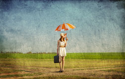 Girl with umbrella and suitcase Royalty Free Stock Photography